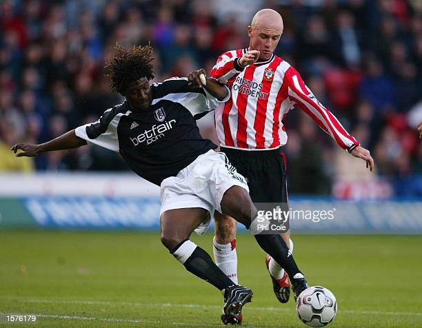 Chris Marsden of Southampton is tackled by Rufus Brevett of Fulham during the FA Barclaycard Premiership match held on October 27 2002 at the The...