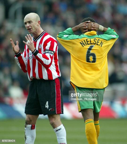 Chris Marsden of Southampton shouts at his defenders as David Neilsen of Norwich City rues a missed shot during their FA Cup Fifth round match at...