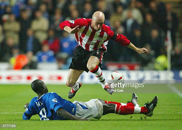 Chris Marsden of Southampton takes on Amdy Faye of Portsmouth during the Carling Cup fourth round match between Southampton and Portsmouth at St...