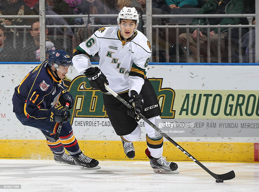 Chris Martenet #86 of the London Knights skates away from Giordano Finoro #11 of the Barrie Colts during an OHL game at Budweiser Gardens on November 25, 2016 in London, Ontario, Canada. The Knights defeated the Colts 4-1.