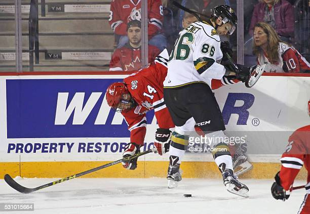 Chris Martenet of the London Knights slams Christopher Paquette of the Niagara IceDogs into the boards during Game Four of the OHL Championship final...
