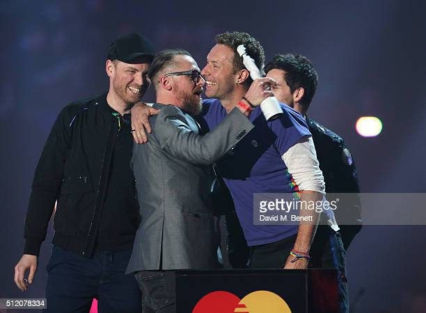 Chris Martin accepts the British Group award on behalf of Coldplay at the BRIT Awards 2016 at The O2 Arena on February 24 2016 in London England