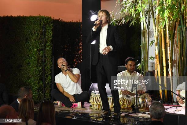 Chris Martin and Beck perform onstage during Hammer Museum's 17th Annual Gala In The Garden on October 12 2019 in Los Angeles California