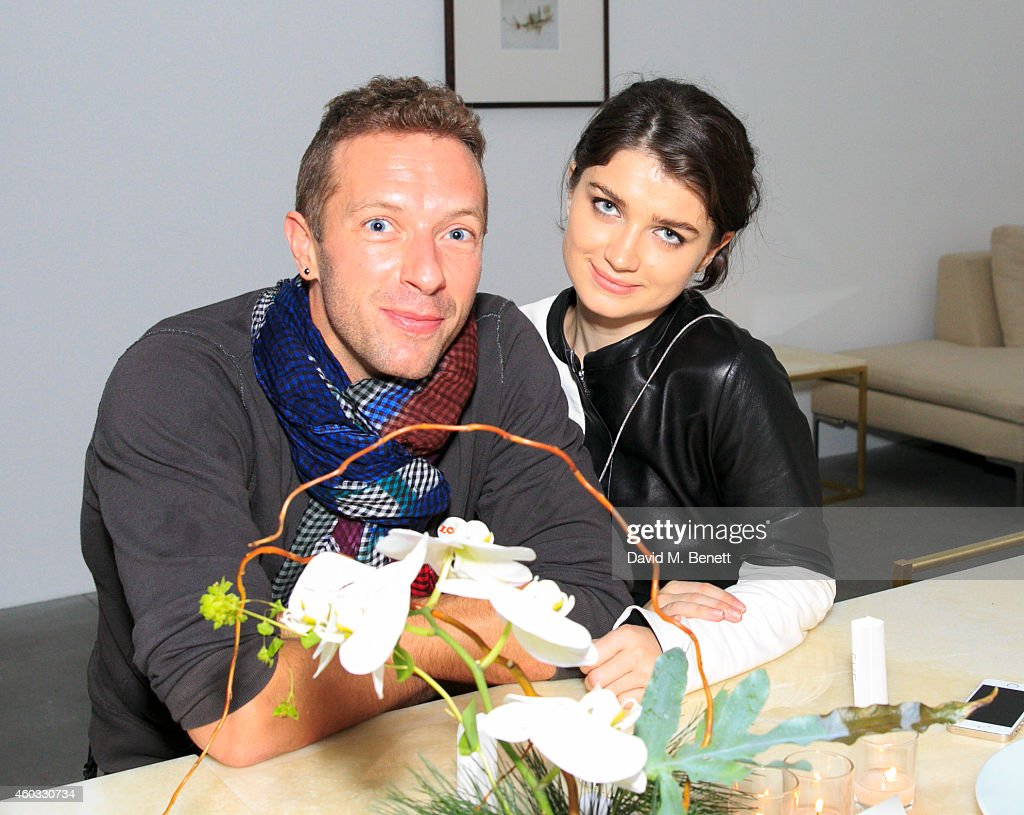 Chris Martin and Eve Hewson attend the Edun Pre Fall Dinner at Alison Jacques Gallery on December 11, 2014 in London, England.