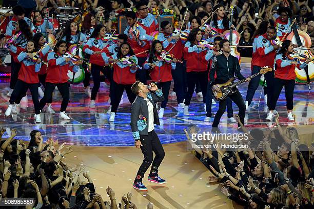 Chris Martin and Guy Berryman of Coldplay perform during the Pepsi Super Bowl 50 Halftime Show at Levi's Stadium on February 7 2016 in Santa Clara...