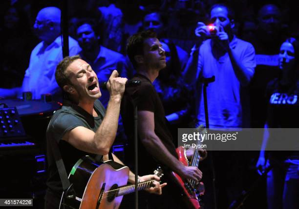 Chris Martin and Guy Berryman of Coldplay perform live on stage at the Royal Albert Hall on July 1 2014 in London England