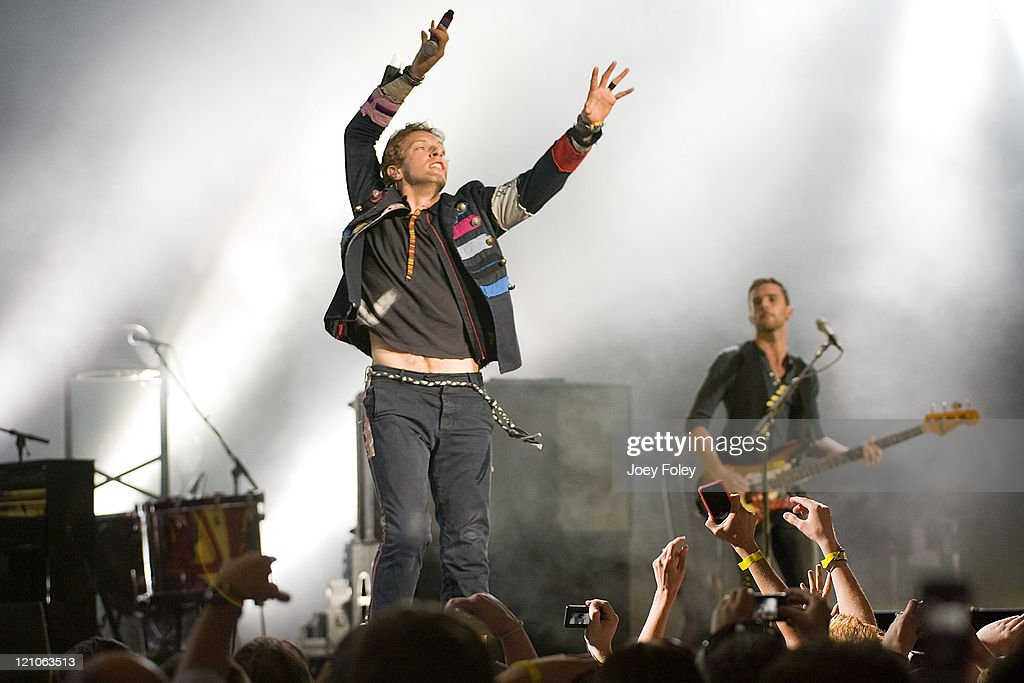 Chris Martin and Guy Berryman of the British alternative rock band Coldplay perform at the Verizon Wireless Music Center on June 5, 2009 in Noblesville, Indiana.