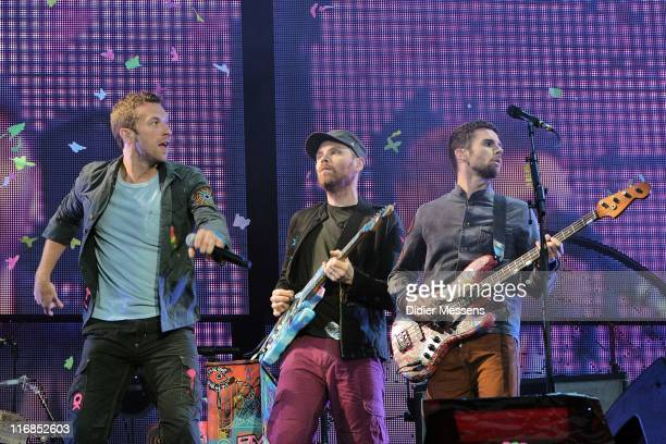 Chris Martin and Jonny Buckland and Guy Berryman of Coldplay of Coldplay perform on stage during the first day of Pinkpop Festival at Megaland on...