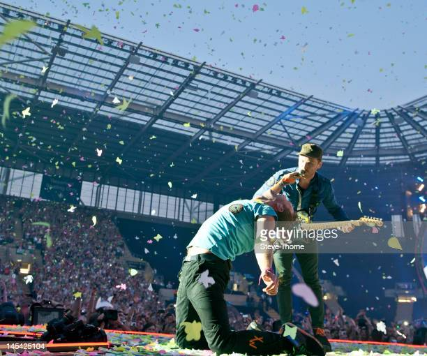Chris Martin and Jonny Buckland of Coldplay perform on stage at Ricoh Arena on May 29, 2012 in Coventry, United Kingdom.