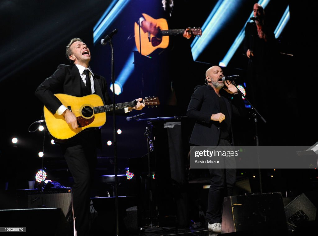 Chris Martin and Michael Stipe perform at '12-12-12' a concert benefiting The Robin Hood Relief Fund to aid the victims of Hurricane Sandy presented by Clear Channel Media & Entertainment, The Madison Square Garden Company and The Weinstein Company at Madison Square Garden on December 12, 2012 in New York City.