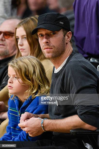 Chris Martin and Moses Martin attend a basketball game between the Golden State Warriors and the Los Angeles Lakers at Staples Center on January 5...