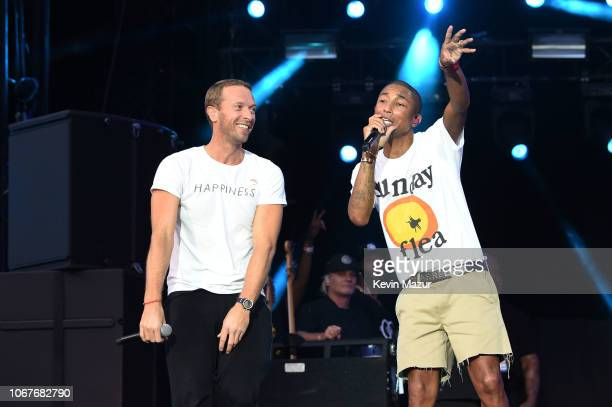 Chris Martin and Pharrell Williams perform during the Global Citizen Festival Mandela 100 at FNB Stadium on December 2 2018 in Johannesburg South...