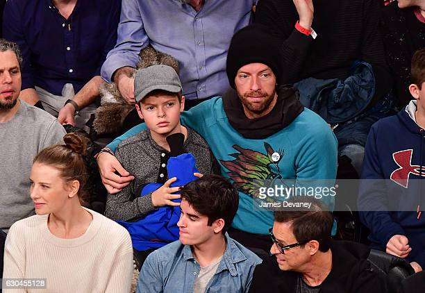 Chris Martin and son Moses Martin attend Golden State Warriors Vs Brooklyn Nets game at Barclays Center on December 22 2016 in New York City