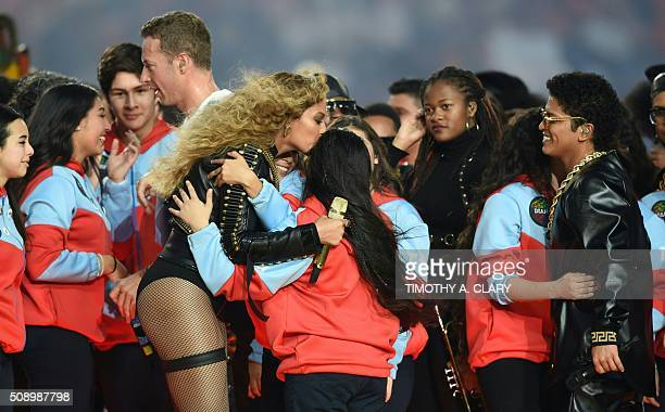 Chris Martin Beyonce and Bruno Mars greet performers after the halftime show during Super Bowl 50 between the Carolina Panthers and the Denver...