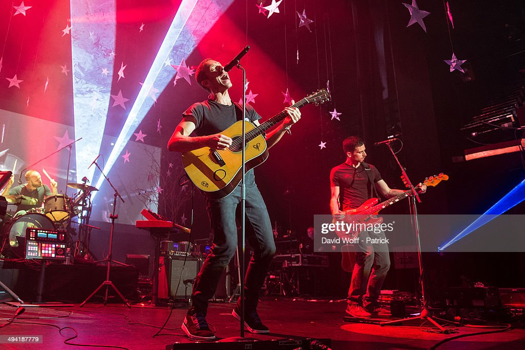 Chris Martin, Guy Berryman and Will Champion from Coldplay perform at Casino de Paris on May 28, 2014 in Paris, France.