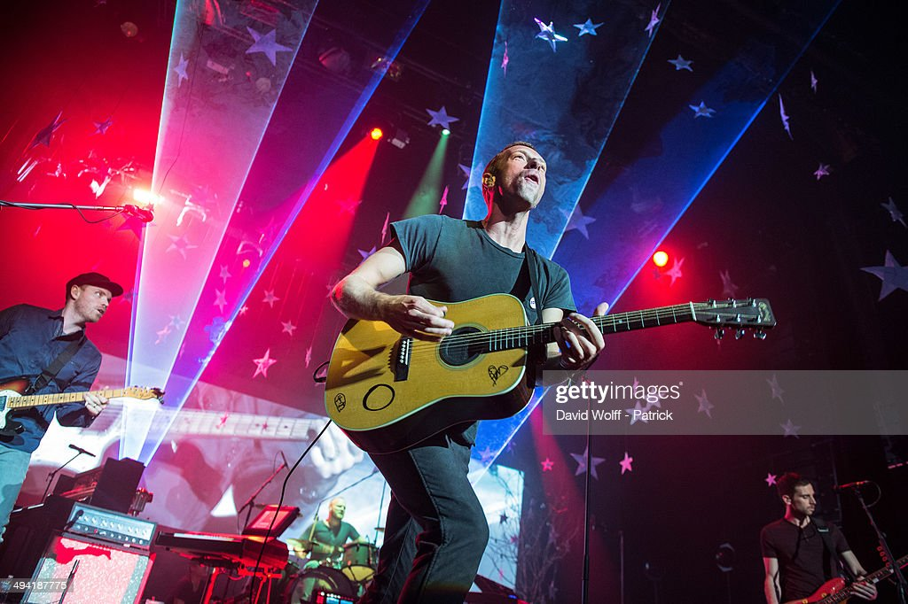 Chris Martin, Guy Berryman, Jon Buckland and Will Champion from Coldplay perform at Casino de Paris on May 28, 2014 in Paris, France.