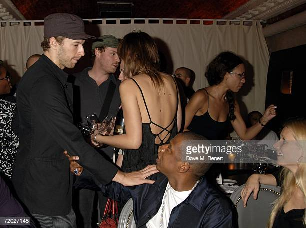 Chris Martin JayZ and Gwyneth Paltrow attend the after party following the concert by JayZ at The Royal Albert Hall at Movida on September 27 2006 in...