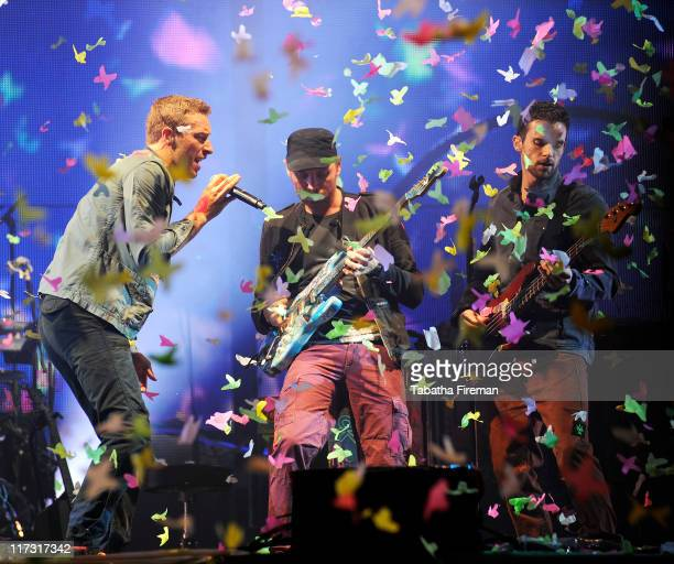 Chris Martin Jonny Buckland and Guy Berryman of Coldplay headline the Pyramid stage on the third day of Glastonbury Festival 2011 at Worthy Farm on...
