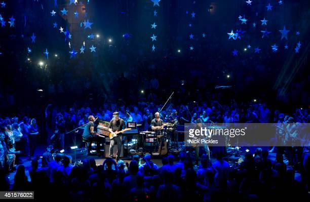 Chris Martin Jonny Buckland Guy Berryman and Will Champion of Coldplay perform at Royal Albert Hall on July 1 2014 in London England