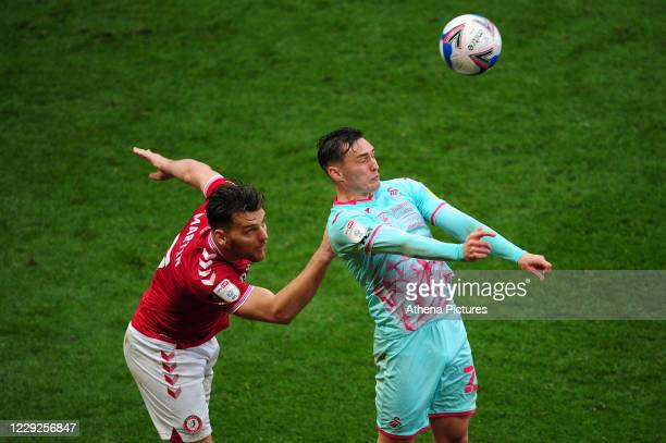 Chris Martin of Bristol City battles with Connor Roberts of Swansea City during the Sky Bet Championship match between Bristol City and Swansea City...
