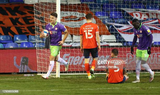 Chris Martin of Bristol City celebrates after his team's first goal, an own goal by Sonny Bradley of Luton Town who looks dejected during the Sky Bet...