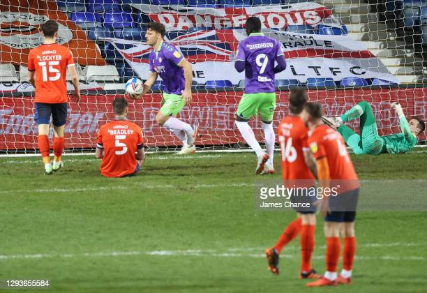 Chris Martin of Bristol City celebrates the first goal which was an own goal by Sonny Bradley of Luton Town during the Sky Bet Championship match...