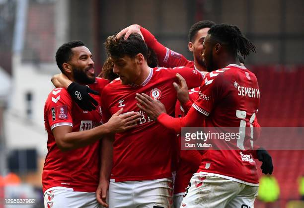 Chris Martin of Bristol City celebrates with Niclas Eliasson, Antoine Semenyo and team mates after scoring their side's second goal during the FA Cup...