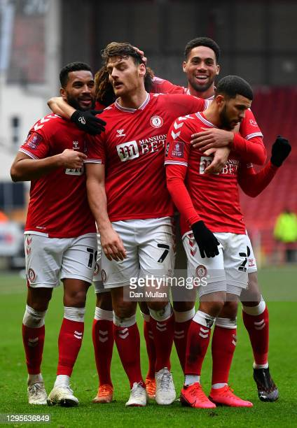 Chris Martin of Bristol City celebrates with team mates Niclas Eliasson and Nahki Wells after scoring their side's second goal during the FA Cup...
