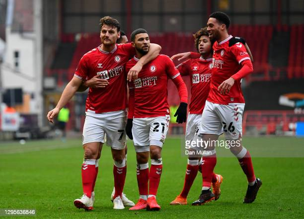 Chris Martin of Bristol City celebrates with teammates Nahki Wells, Han-Noah Massengo and Zak Vyner after scoring their team's second goal during the...