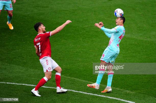 Chris Martin of Bristol City vies for possession with Ben Cabango of Swansea City during the Sky Bet Championship match between Bristol City and...