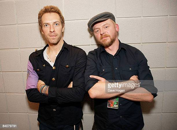 Chris Martin of Coldplay and actor Simon Pegg pose backstage at the O2 arena before Coldplay go onstage on December 16 2008 in London England