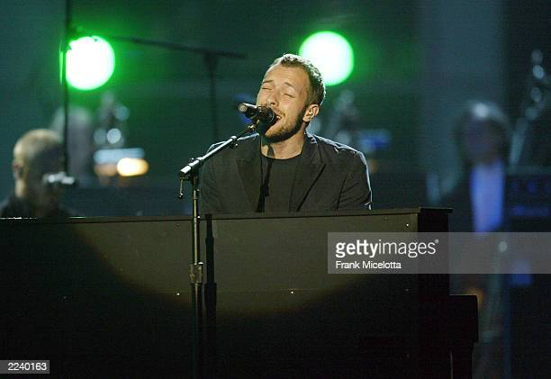 Chris Martin of Coldplay performs at the 45th Annual Grammy Awards at Madison Square Garden on February 23 2003 in New York City