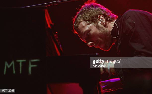 Chris Martin of Coldplay performs at the Coachella Valley Music and Arts Festival at the Empire Polo Fields on April 30 2005 in Indio California