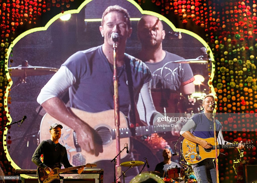 Chris Martin of Coldplay (R) performs on stage at BC Place on September 29, 2017 in Vancouver, Canada.