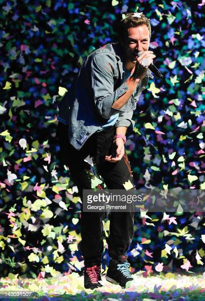 Chris Martin of Coldplay performs onstage to open their North American tour at the Rexall Place on April 17 2012 in Edmonton Canada