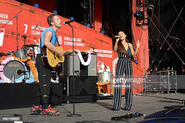 Chris Martin of Coldplay performs with Ariana Grande onstage during 2015 Global Citizen Festival to end extreme poverty by 2030 in Central Park on...