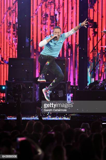 Chris Martin of Coldplay performs with The Chainsmokers on stage at The BRIT Awards 2017 at The O2 Arena on February 22 2017 in London England