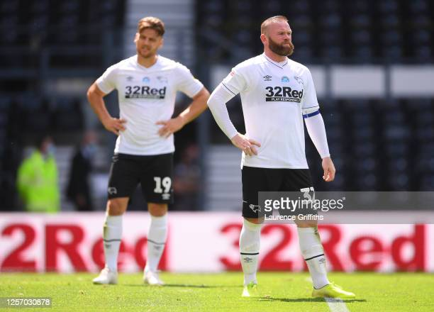 Chris Martin of Derby County and Wayne Rooney of Derby County look on dejected during the Sky Bet Championship match between Derby County and Leeds...