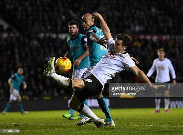Chris Martin of Derby County battles with Alex Baptiste of Blackburn Rovers during the Sky Bet Championship match between Derby County and Blackburn...
