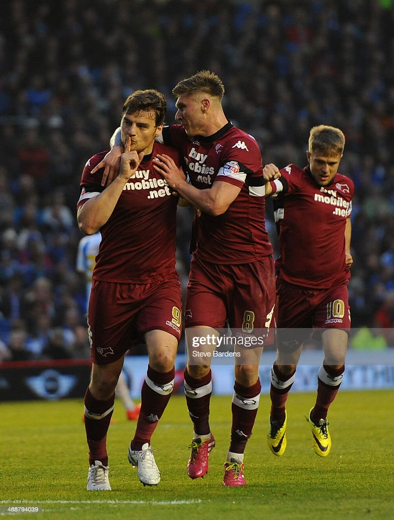 Chris Martin of Derby County (L) celebrates scoring from the penalty spot with his team mates during the Sky Bet Championship Play Off semi final first leg match between Brighton & Hove Albion and Derby County at Amex Stadium on May 8, 2014 in Brighton, England.