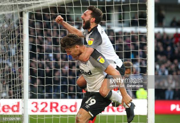 Chris Martin of Derby County celebrates with Graeme Shinnie after scoring their third goal from the penalty spot during the Sky Bet Championship...