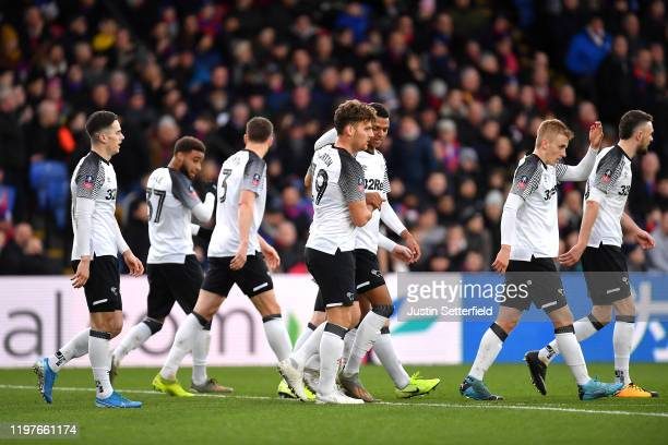 Chris Martin of Derby County celebrates with teammates after scoring his team's first goal during the FA Cup Third Round match between Crystal Palace...