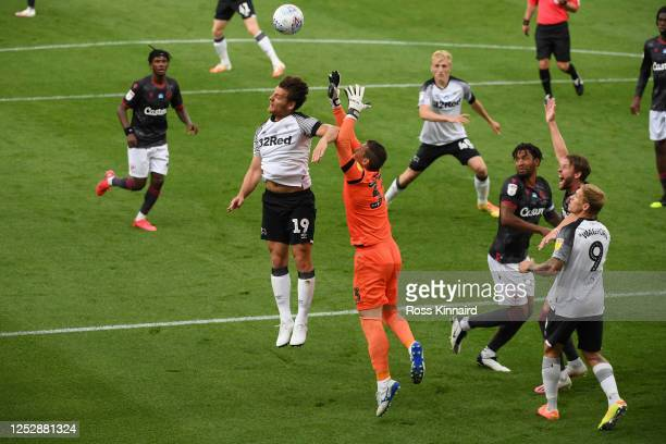 Chris Martin of Derby County challenges for the ball with goalkeeper Rafael of Reading during the Sky Bet Championship match between Derby County and...