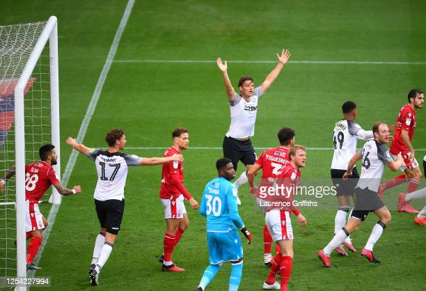 Chris Martin of Derby County claims to the referee after he scores his sides first goal during the Sky Bet Championship match between Derby County...