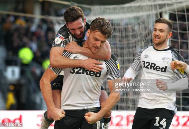 Chris Martin of Derby County is mobbed by team mates after scoring their third goal from the penalty spot during the Sky Bet Championship match...
