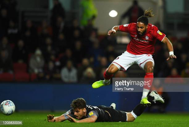 Chris Martin of Derby County is tackled by Ashley Williams of Bristol City during the Sky Bet Championship match between Bristol City and Derby...