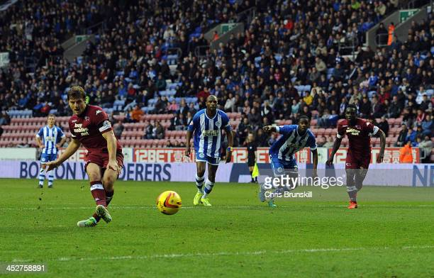 Chris Martin of Derby County scores his side's third goal from the penalty spot during the Sky Bet Championship match between Wigan Athletic and...
