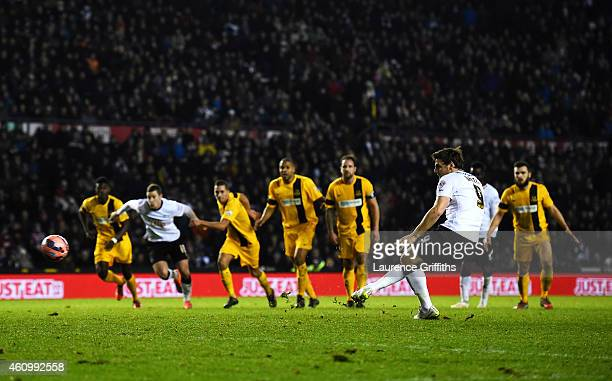 Chris Martin of Derby scores the winning goal from the penalty spot during the FA Cup Third Round match between Derby County and Southport FC at iPro...
