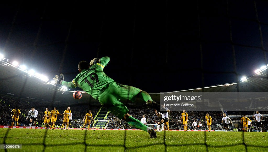 Chris Martin of Derby scores the winning goal from the penalty spot past David Raya Martin of Southport during the FA Cup Third Round match between Derby County and Southport FC at iPro Stadium on January 3, 2015 in Derby, England.