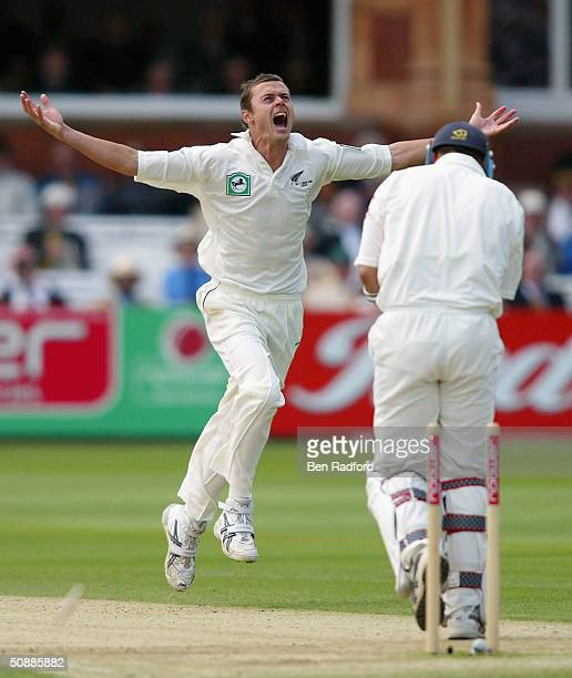 Chris Martin of New Zealand celebrates bowling out Nasser Hussain of England during the third day of the first npower test match between England and...